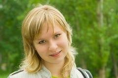 Portrait of green-eyed girl. Nice green-eyed girl walking in park Stock Image