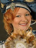 Portrait of green-eyes smiling girl in Polish clothes of 16 cent royalty free stock photography
