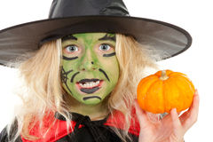Portrait of green Halloween witch in closeup royalty free stock image