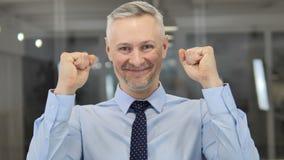 Portrait of Grey Hair Businessman Celebrating Success stock footage