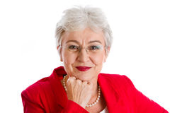 Portrait of a grey haired senior business woman isolated on whit. Portrait of a senior businesswoman isolated on white with a red jacket Royalty Free Stock Photo