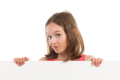 Portrait of a grimacing girl behind placard Stock Photography