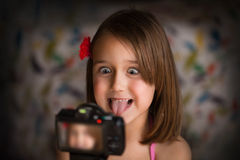 Portrait of grimacing girl Stock Images