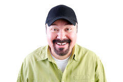 Portrait of grinning man in baseball cap Royalty Free Stock Photos