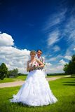 Portrait of the groom and the bride on the nature Royalty Free Stock Photography