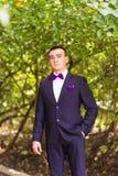 Portrait of groom in garden Stock Photography