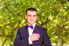 Portrait of groom in garden Stock Photos