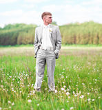 Portrait of the groom outdoors on their wedding day Stock Images