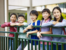 Portrait of a group of asian elementary school children. Portrait of a group of happy and smiling elementary school students royalty free stock photos