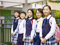Portrait of a group of asian elementary school children. Looking at camera smiling royalty free stock photo