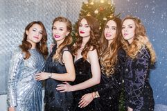Portrait of a group of beautiful young women in the new year, Christmas. New year party, holidays, celebration, people concept stock photos
