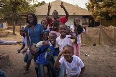Portrait of a group of children playing and smiling, at the Bissaque neighborhood in the city of Bissau. Bissau, Republic of Guinea-Bissau - January 29, 2018 royalty free stock photography