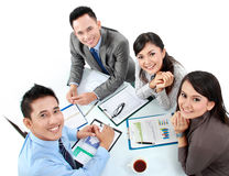 Portrait of group executives. Meeting around a table with many paperwork stock photos