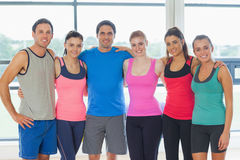 Portrait of a group of fitness class at exercise room Stock Images