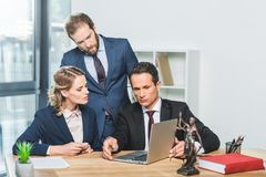 Lawyers with laptop in office Stock Image