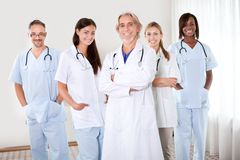 Portrait of group of friendly doctors Stock Photos