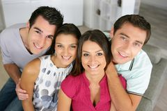 Portrait of group of friends. Group of 4 happy friends gathering at home Stock Photography