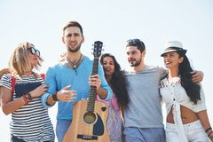 Portrait of group of friends going to on the beach. Mixed group of friends walking on the beach on summer day Royalty Free Stock Image
