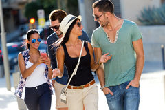 Portrait of group friends having fun in the street. Royalty Free Stock Photography