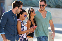 Portrait of group friends having fun in the street. Royalty Free Stock Photo