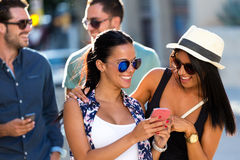 Portrait of group friends having fun in the street. Royalty Free Stock Images