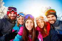 Portrait group of friends skiers on winter holidays. Portrait group of smiling friends skiers on winter holidays Royalty Free Stock Image
