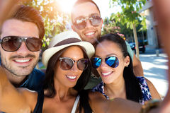 Portrait of group friends taking photos with a smartphone. Royalty Free Stock Photos