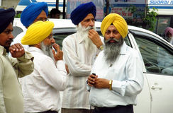 Portrait of a group of Sikhs in India with nationa Royalty Free Stock Image