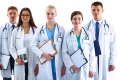 Portrait of group of smiling hospital colleagues standing together Stock Photos