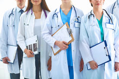 Portrait of group smiling hospital colleagues standing together Stock Photos
