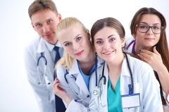 Portrait of group of smiling hospital colleagues standing together . Doctors Stock Images