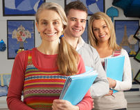 Portrait Of Group Of Teachers In Classroom. Smiling At Camera royalty free stock photos