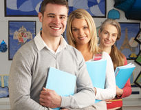 Portrait Of Group Of Teachers In Classroom. Smiling At Camera Royalty Free Stock Photography