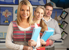 Portrait Of Group Of Teachers In Classroom. Smiling At Camera stock image