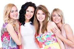 Portrait of group young beautiful smiling women. Portrait of group young beautiful smiling women in pink dresses - isolated on white stock image