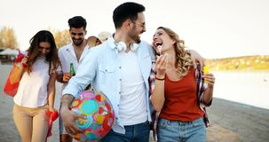 Portrait of group of young friends having a party. On the beach stock photos