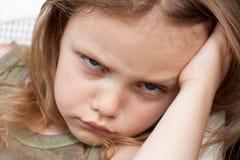 Grumpy girl. Portrait of a grumpy little girl Royalty Free Stock Photo