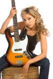 Portrait of Guitar girl. Portrait of Girl sitting on the box with bass guitar Stock Photos
