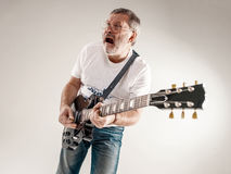 Portrait of a guitar player Royalty Free Stock Image