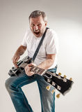 Portrait of a guitar player Royalty Free Stock Photography