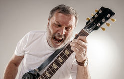 Portrait of a guitar player Stock Image