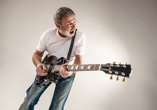 Portrait of a guitar player Stock Photography