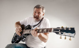 Portrait of a guitar player Stock Photos