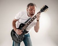Portrait of a guitar player Stock Photo
