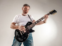Portrait of a guitar player Stock Images
