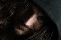Portrait of guy with big nose. Diagonal portrait of a guy with long hair and big nose; low key Stock Photos