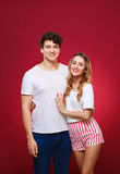 Portrait of a guy with a girl in pin-up style, isolated on a red Royalty Free Stock Image