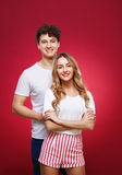 Portrait of a guy with a girl in pin-up style, isolated on a red Royalty Free Stock Photos