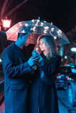 Portrait of a guy and a girl under an umbrella Royalty Free Stock Photo