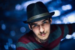 Portrait of a guy in a hat on a blurred background royalty free stock images